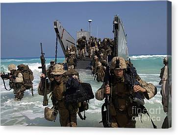 Marines Disembark A Landing Craft Canvas Print by Stocktrek Images