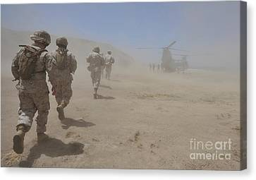 Marines Move Through A Dust Cloud Canvas Print by Stocktrek Images