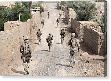 Marines Patrol The Streets Of Iraq Canvas Print by Stocktrek Images