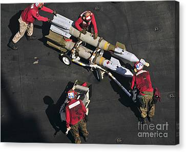 Marines Push Pordnance Into Place Canvas Print by Stocktrek Images