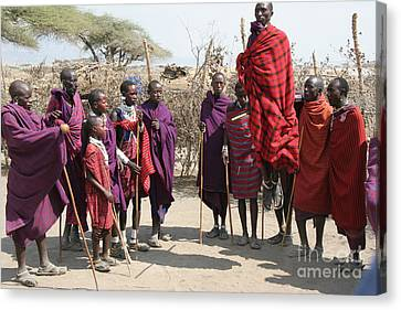 Masai Warriors Jumping Canvas Print by Scotts Scapes