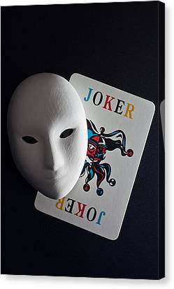 Mask And Joker Canvas Print by Kantapong Phatichowwat