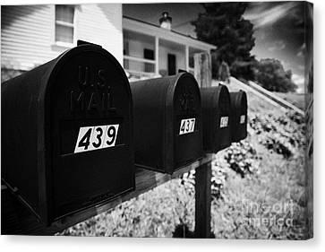 matt black american private mailboxes in front of houses Lynchburg tennessee usa Canvas Print by Joe Fox