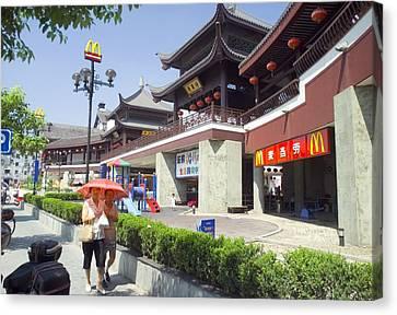 Mcdonalds Restaurant In Shanghai China Canvas Print by Everett