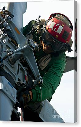 Mechanic Inspects An Mh-60r Sea Hawk Canvas Print by Stocktrek Images