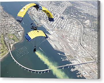 Members Of The U.s. Navy Parachute Team Canvas Print by Stocktrek Images
