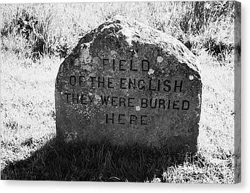 memorial stone for the dead english on Culloden moor battlefield site highlands scotland Canvas Print by Joe Fox