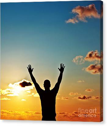 Men Silhouette At Sunset Canvas Print by Anna Om