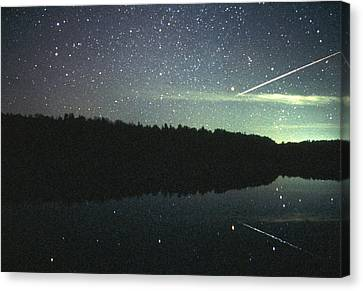 Meteor Over Lake Canvas Print by Pekka Parviainen