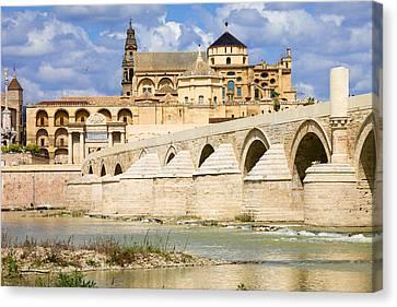 Mezquita Cathedral And Roman Bridge In Cordoba Canvas Print by Artur Bogacki