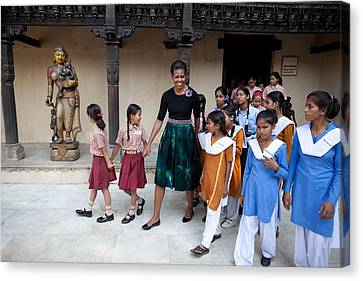 Michelle Obama Accompanied By Children Canvas Print by Everett