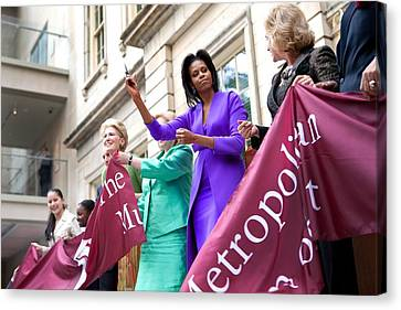 Michelle Obama Cuts The Ribbon Canvas Print by Everett