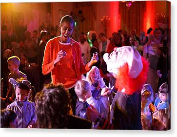 Michelle Obama Dancing With Children Canvas Print by Everett