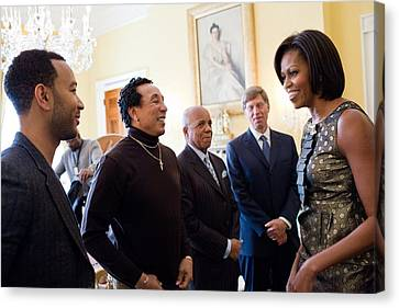 Michelle Obama Greets John Legend Canvas Print by Everett