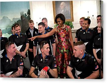 Michelle Obama Talks With Participants Canvas Print by Everett