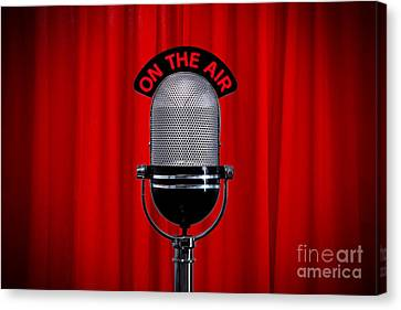 Microphone On Stage With Spotlight On Red Curtain Canvas Print