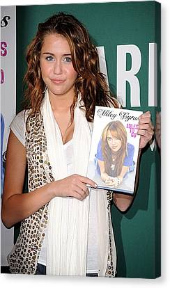 Miley Cyrus At In-store Appearance Canvas Print by Everett