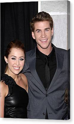Miley Cyrus, Liam Hemsworth At Arrivals Canvas Print by Everett