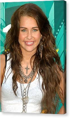 Miley Cyrus Wearing  Jewelry By Loree Canvas Print by Everett