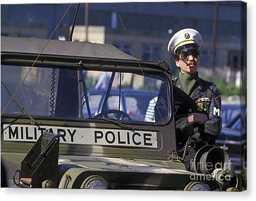 Military Policeman Stands Next Canvas Print