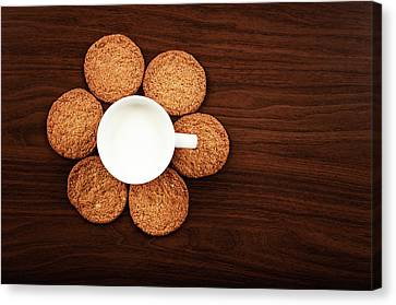 Milk And Cookies On Table Canvas Print by Elias Kordelakos Photography