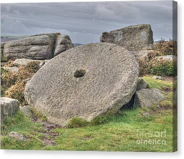 Millstone On Edge Canvas Print by Steev Stamford
