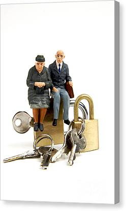 Miniature Figurines Of Elderly Couple Sitting On Padlocks Canvas Print by Bernard Jaubert