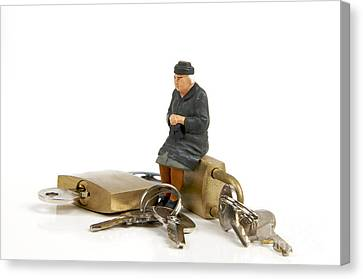 Miniature Figurines Of Elderly Sitting On Padlocks Canvas Print