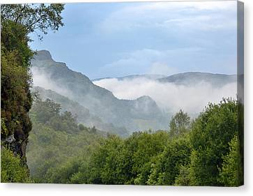Misty Mountains Canvas Print by Ronnie Reffin