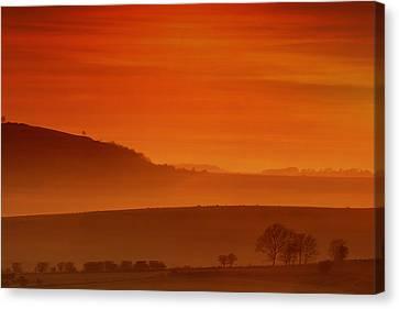 Misty Sunset Canvas Print by Mark Leader