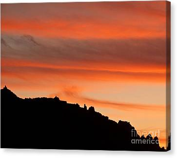 Moab Rim Sunset Canvas Print by Bob and Nancy Kendrick