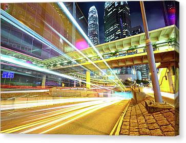 Modern City At Night Canvas Print by Leung Cho Pan