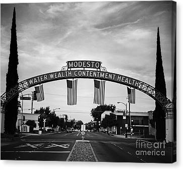 Modesto Arch With Flags Canvas Print by Jim and Emily Bush