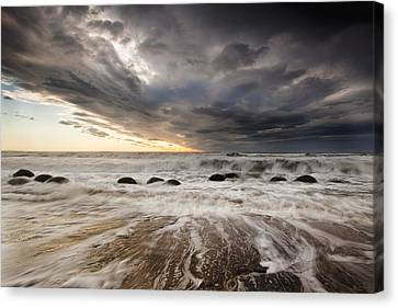 Moeraki Boulders At Dawn With Storm Canvas Print by Colin Monteath