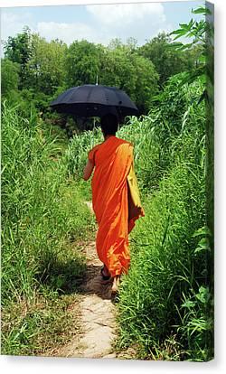 Monk Walking, Luang Prabang, Laos Canvas Print by Thepurpledoor