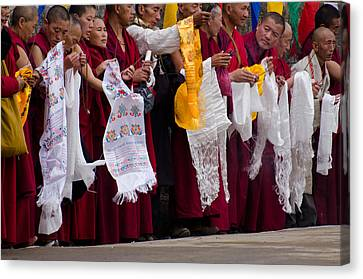 Canvas Print featuring the photograph Monks Wait For The Dalai Lama by Don Schwartz