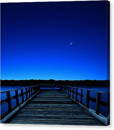 Moon And Venus In The Blue Canvas Print by Carlos Gotay