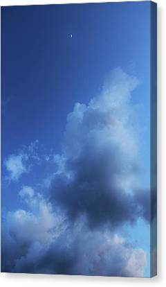 Moon In A Cloudy Sky At Twilight Canvas Print by Gal Ashkenazi