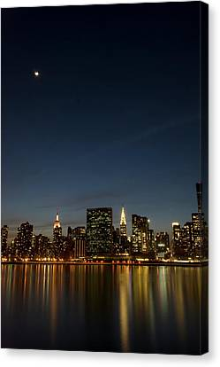 Moon Over Manhattan Canvas Print by Photographs by Vitaliy Piltser