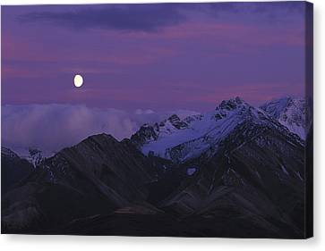 Moon Over Mountains Canvas Print by Nick Norman