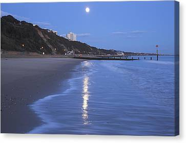 Moon Reflecting In The Sea, Bournemouth Beach, Dorset, England, Uk Canvas Print by Peter Lewis