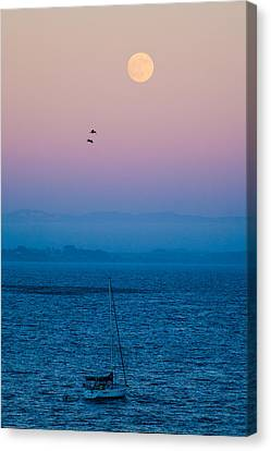 Moonrise Over Capitola Canvas Print by Tommy Farnsworth
