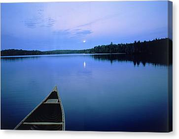 Moonrise W/ Canoe, Boundary Waters, Mn Canvas Print by A & C Wiley/Wales