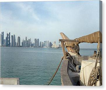 Moored Dhow And Doha Canvas Print by Paul Cowan