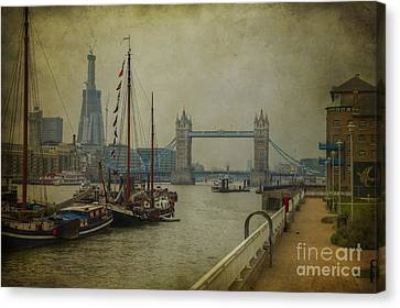 Canvas Print featuring the photograph Moored Thames Barges. by Clare Bambers