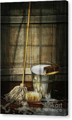 Mop With Bucket And Scrub Brushes Canvas Print by Sandra Cunningham