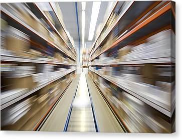 Fast Shipping Canvas Print - Motion Blur Of A Warehouse Conveyor Belt by John Short