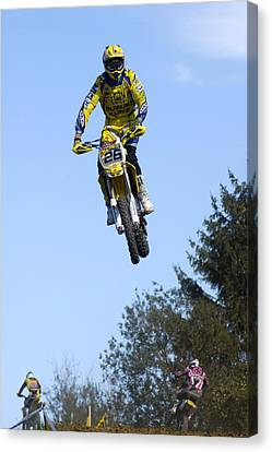 Motocross Rider Jumping High Canvas Print by Matthias Hauser