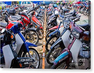 Motor Cycle Parking  Canvas Print by John Buxton