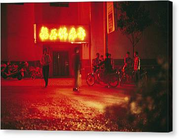 Motorcyclists Outside A Karaoke Bar Canvas Print by Justin Guariglia